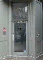 Fun with captions over the door - opposite Mirrorman, London